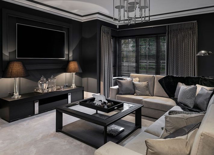 Patsy Blunt Interiors Media Room with black furniture and walls