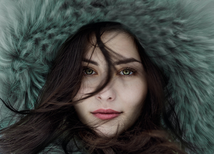 classic no-makeup look woman in fur hood with beautiful skin