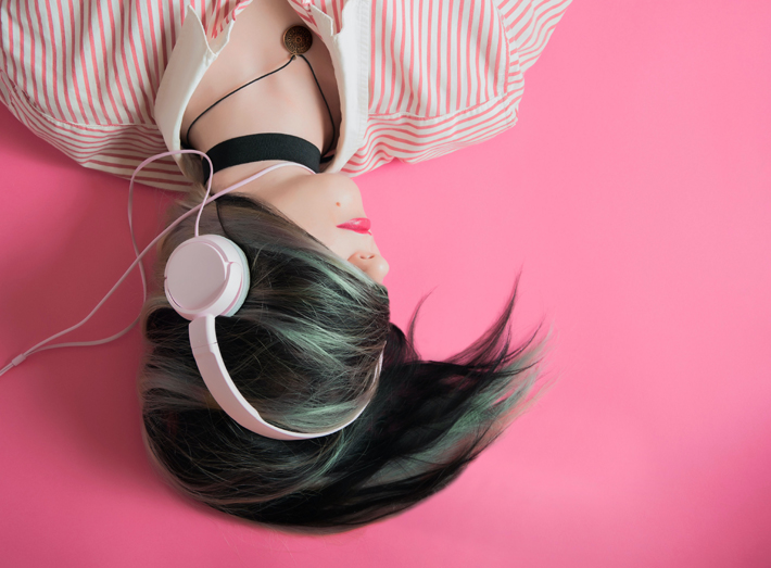 best fashion podcast woman with headphones on elice moore unsplash