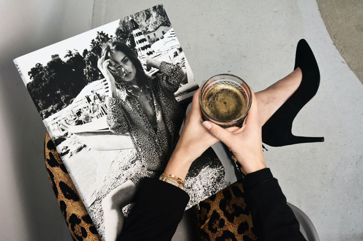 top popular fashion magazines stylish woman reading magazine in leopard pants with coffee
