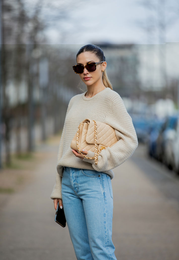 Ann-Kathrin Götze wearing beige Ferragamo jumper, denim jeans Saint Laurent, Chanel bag in beige, Dior sunglasses Dior (Photo by Christian Vierig/Getty Images)