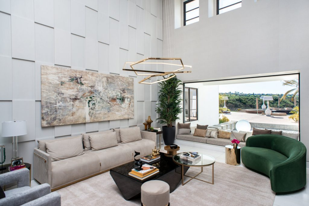 A stunning living room with a beautifully executed window seat designed by 2id Interiors