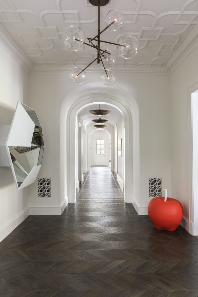kes studio kara smith white hallway design with modern ceiling details red apple art