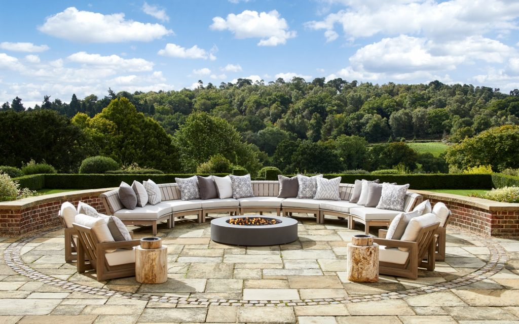 Surrey Hill residence designed by London Projects large c shaped outdoor sofa with round fire pit