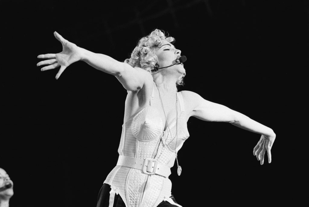 fashion empowered women Madonna, vocal performs at the Feijenoord Stadium with Blonde ambition tour in Rotterdam, the Netherlands on 24th July 1990. (Photo by Frans Schellekens/Redferns)
