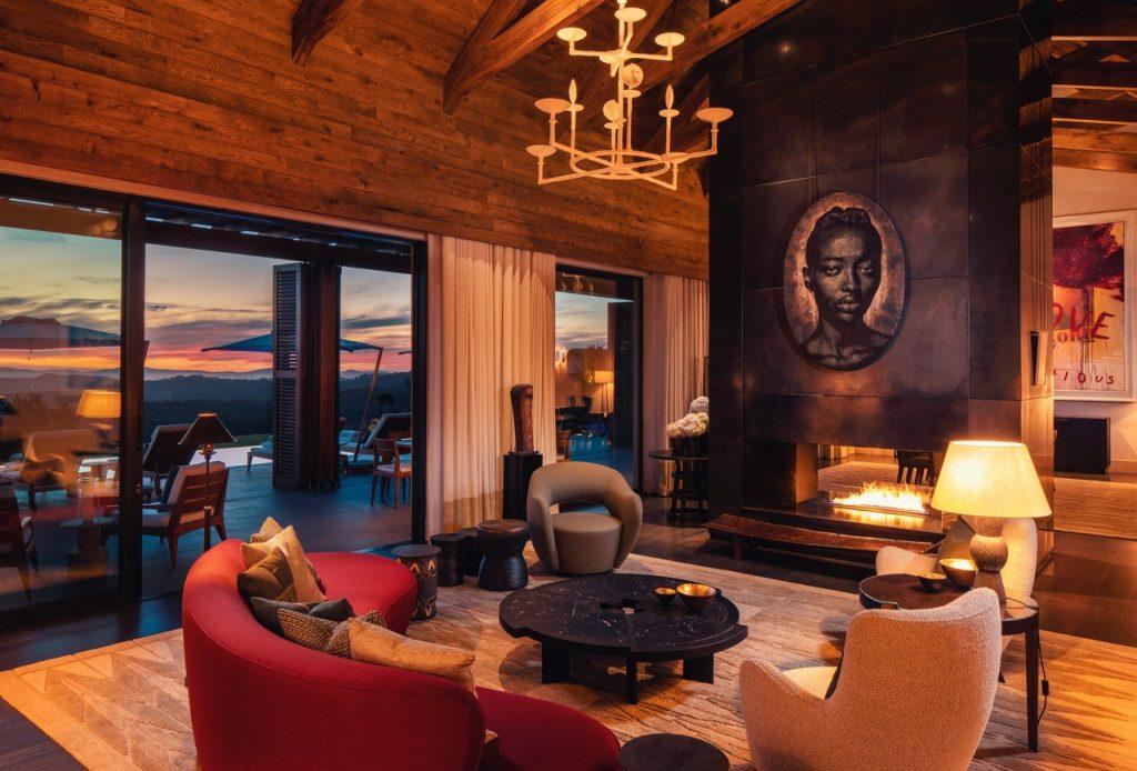 david collins studio owners villa delaire graff fireplace sunset view porch deck