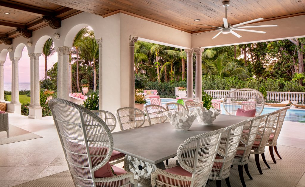 Outdoor dining area designed by Lori Morris (Photo by Brandon Barre) luxury pool pink and white