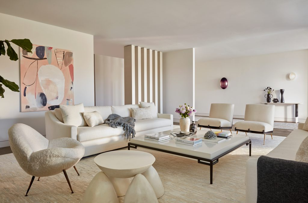 luxury living room beach house A clean white palette makes for the perfect space to showcase special art, accessories and vacation fun finds. Interior by Sara Story. (Photo by Roger Davies)