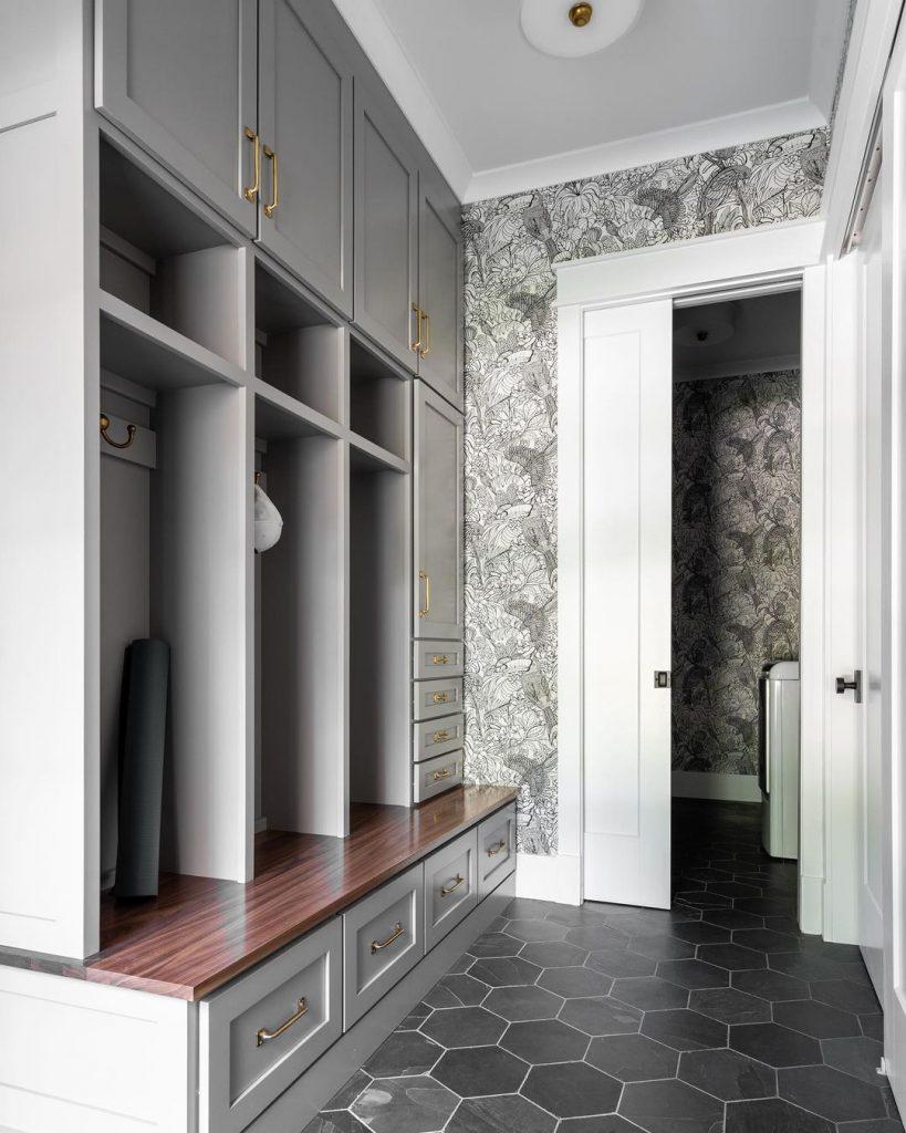c and m interiors mudroom dark floor gray cabinets