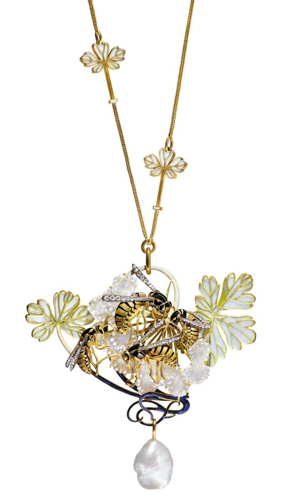 An Art Nouveau enamel, diamond, and pearl pendent necklace, by René Lalique. This stunning design sold in 2017 for $978,400, the record auction price for Art Nouveau jewelry and Lalique creations. Source: Christie's