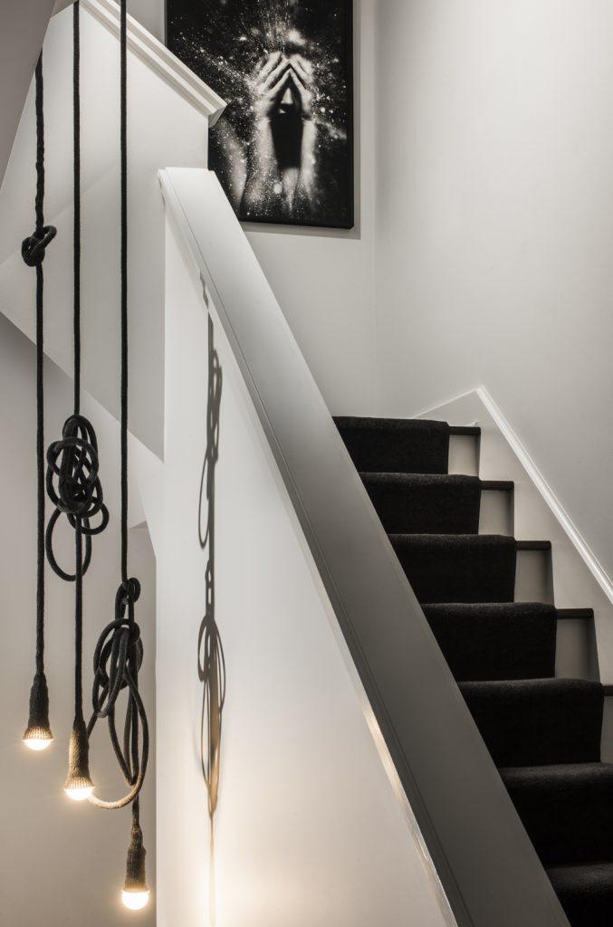 black and white stair case modern interior design by brianne bishop buckstown chicago