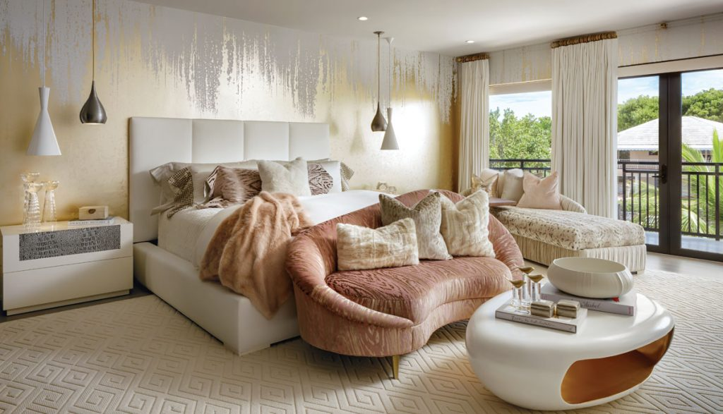 cream and pink bedroom florida by lori morris with loveseat at the end of the bed and chaise by the window