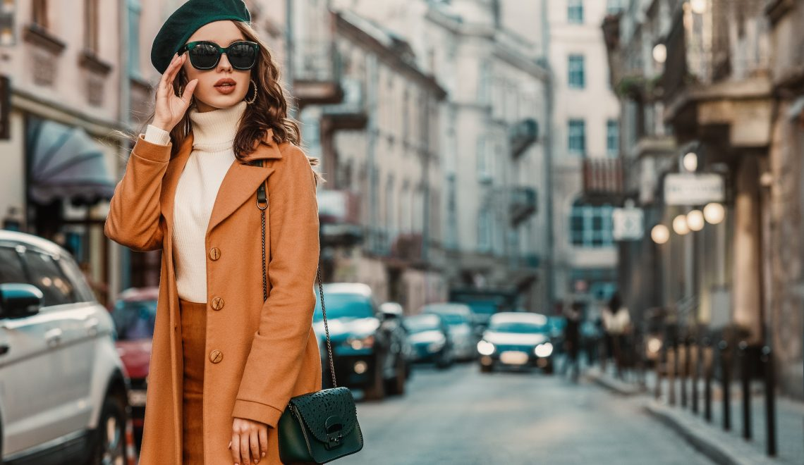 wardrobe style tips dressing for confidence Outdoor autumn portrait of young elegant fashionable woman wearing trendy sunglasses, camel color coat, turtleneck, with textured leather shoulder bag, walking in street of European city