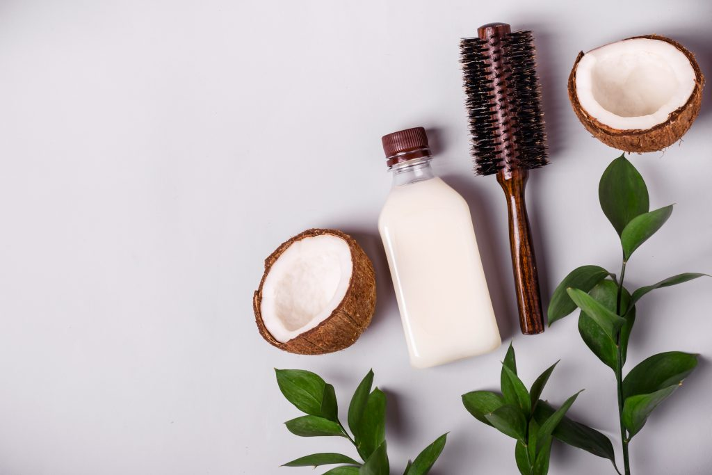 Coconut oil and tropical leaves. proper Hair care spa concept