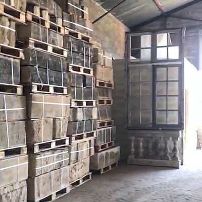 a french chateau style home for sale by alisanne frew - A surviving 11' window of the château, alongside stones packed onto their new pallets, ready for shipment