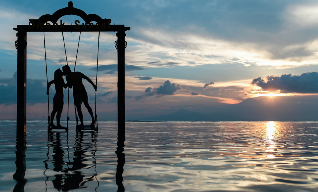 spoil your man couple on swings in ocean dream vacation