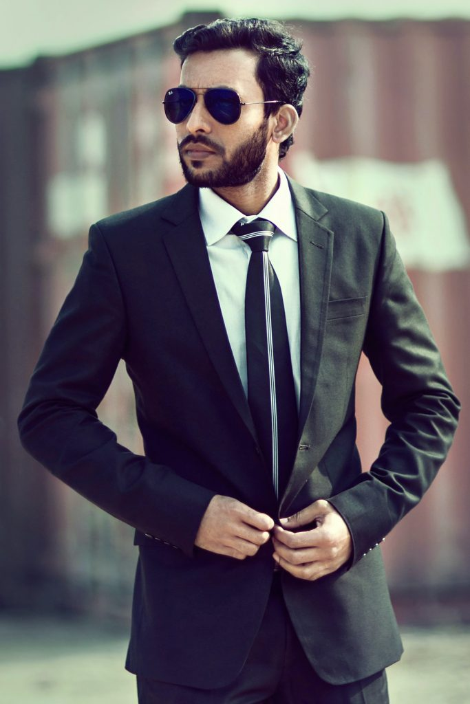 man in black suit confident well dressed