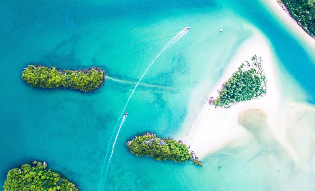 beach aerial view top private jet destinations vacation spots denys nevozhai unsplash