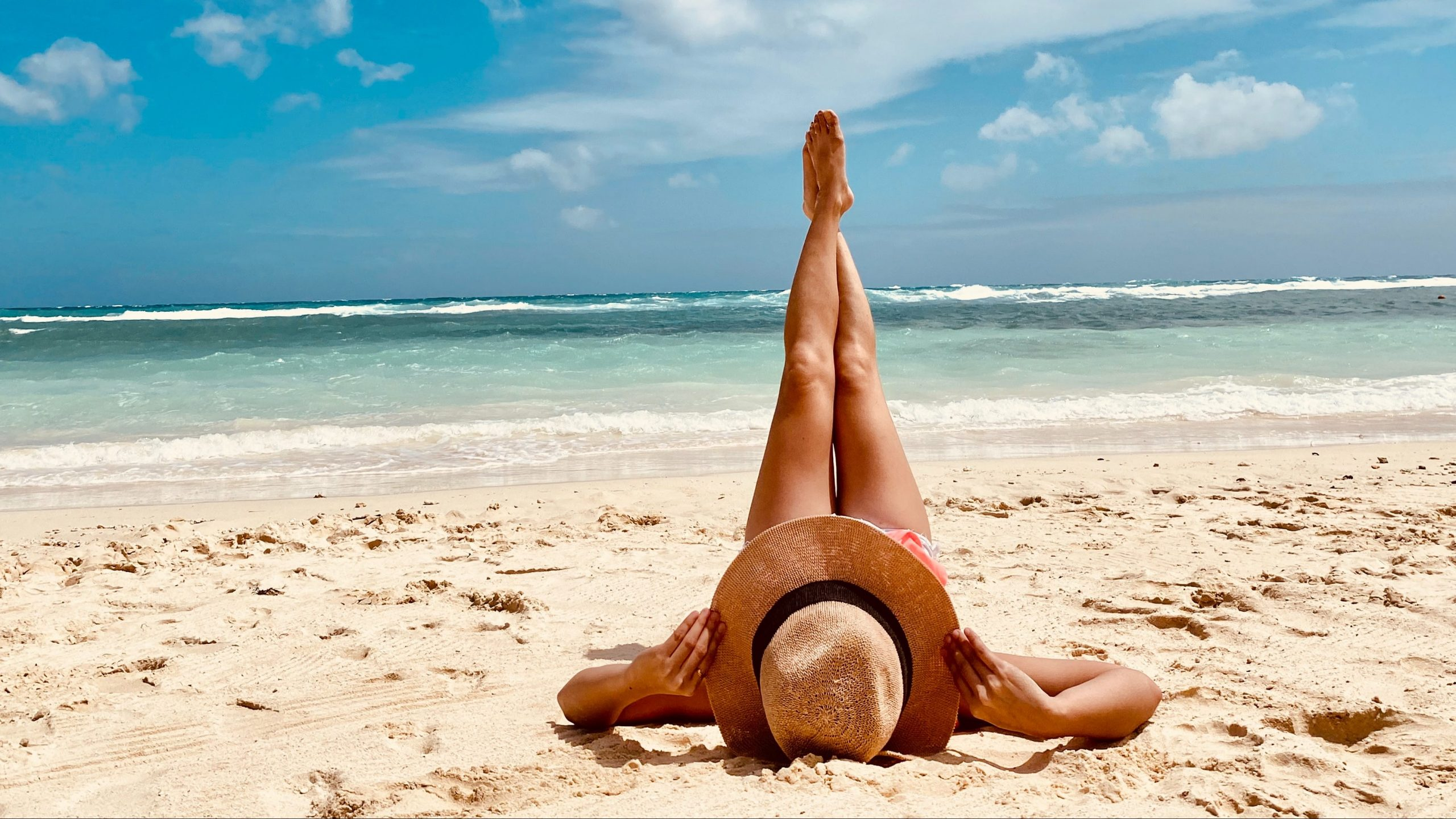woman laying in the sand Boracay, Malay, Philippines (Photo by Apple Bautista)