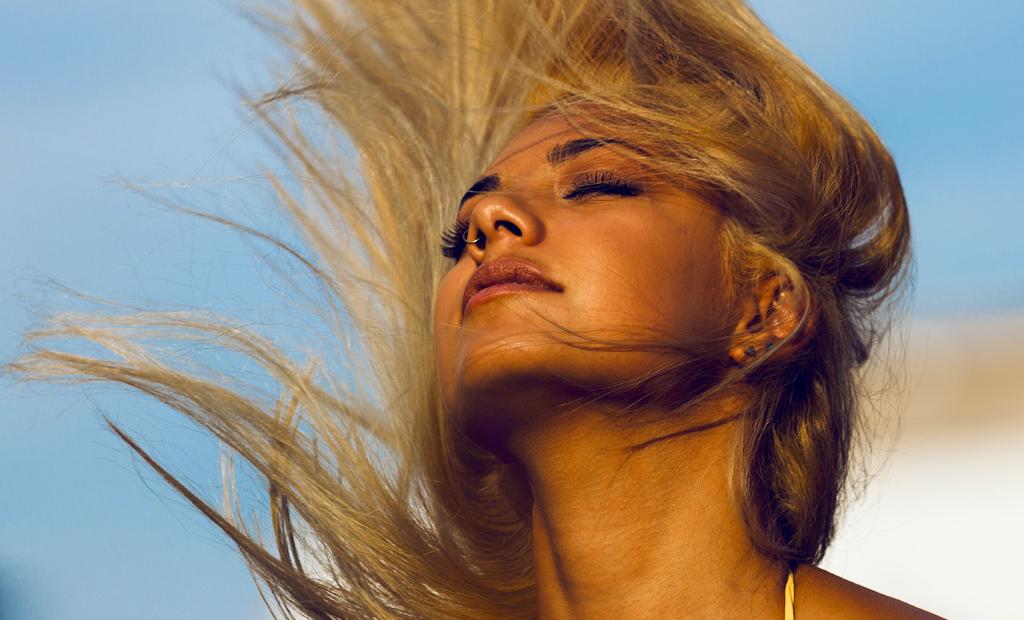 humid frizz free hair beautiful woman in the sunayo ogunseind