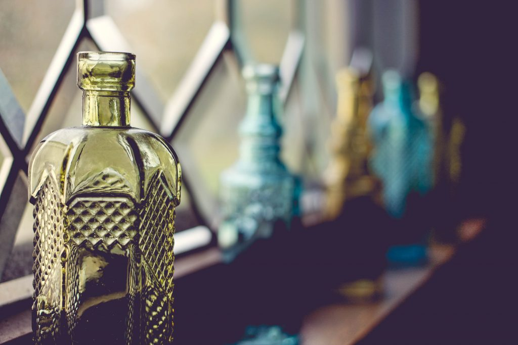 how to decorate your window sills with style using glass bottles accessories
