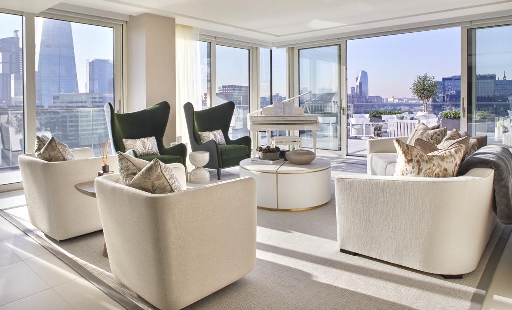 taylor howes design living room london flat netural palette pops of green