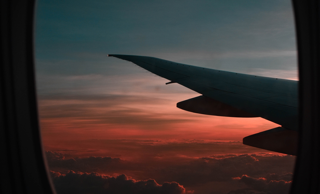 covid travel tips during - airplane at sunset