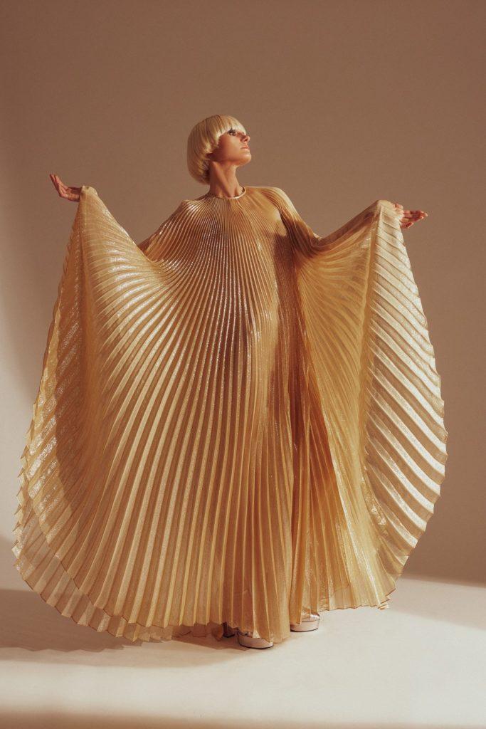 designer halston x netflix collection gold pleated dress